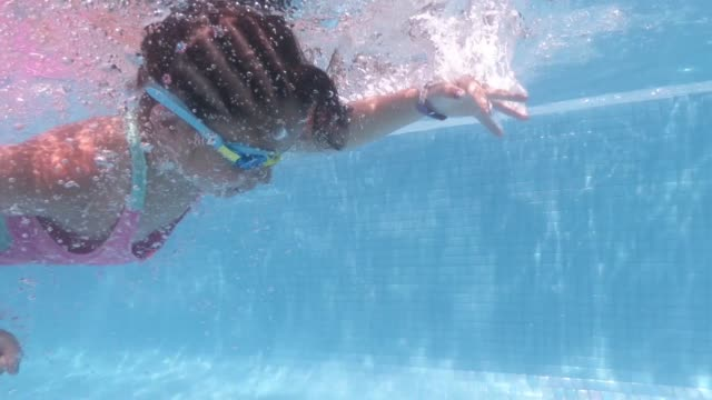 8 years old girl swimming underwater in swimming pool - 8 9 years stock videos & royalty-free footage
