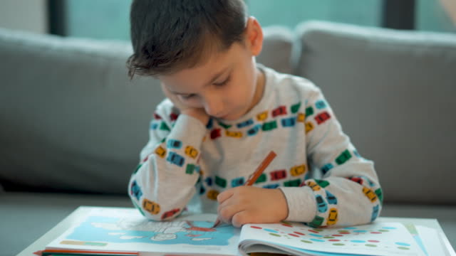 4-5 years old little boy doing homework, coloring pages - 4 5 years stock videos & royalty-free footage