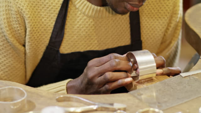 33 years old male self-employed goldsmith of african origin in his workshop. - aspirations stock videos & royalty-free footage