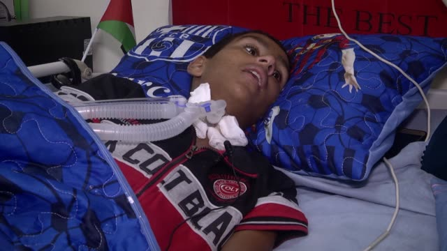 years old palestinian boy nureddin ebu bekir lies on bed after an israeli bullet went through his shoulder and flied out of his neck, causing... - paralysis stock videos & royalty-free footage