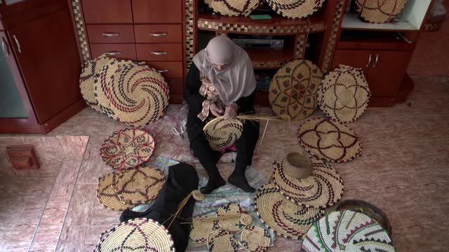 years old palestinian woman nazmiye hasan makes various type of handmade straw trays and baskets at her home in nablus, west bank on october 27,... - container stock videos & royalty-free footage