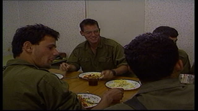 vidéos et rushes de story 1 west bank ramallah int israeli soldier prepares for a shave soldier shaves as face seen in mirror soldier out of door and along int soldier... - israël
