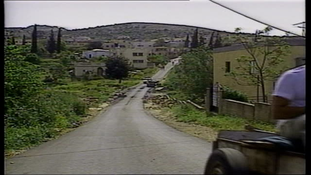 Story Two ISRAEL Barta Houses of town on hillside the town was split into two by the creation of the state of Israel END OF GRAPHIC STRAP Man riding...
