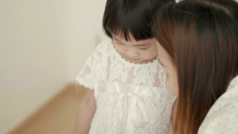 2-3 years  simple living : playful mother and daughters in bedroom - 2 3 years stock videos & royalty-free footage