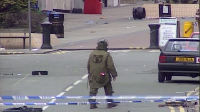 25 years since ira bombs killed two in warrington bsp200393016 / tx bomb disposal man in protective clothing on far side of cordon in debris littered... - disposal stock videos and b-roll footage