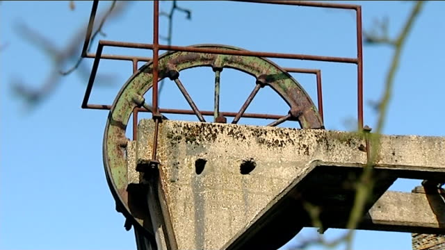 30 years since start of miners' strike england south yorkshire ext old pit wheel at disused coal mine pull headframe at disused mine shaft sign... - keep out sign stock videos & royalty-free footage