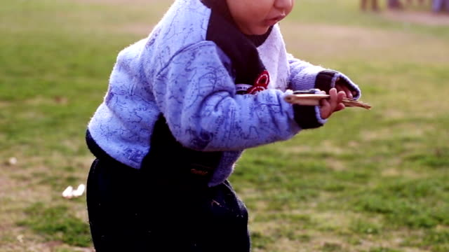 2-3 years toddler playing with wooden stick - 2 3 years stock videos & royalty-free footage