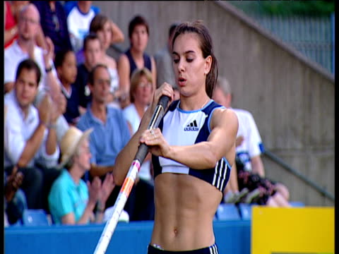 Yelena Isinbayeva deep in concentration motivating herself explodes down the runway and leaps over the bar to set New World Record of 490m Women's...
