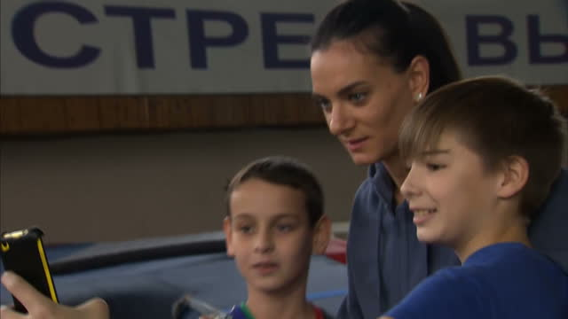 Yelena Isinbayeva speaks out against ban on Russian athletes Shows interior shots Yelena Isinbayeva taking pictures with young fans inside athletics...