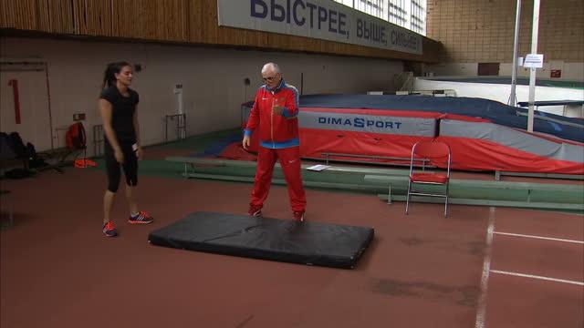 Yelena Isinbayeva speaks out against ban on Russian athletes Shows interior shots Yelena Isinbayeva doing drills with her coach Evgeni Trofimov on...