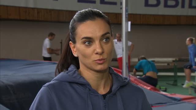 Yelena Isinbayeva speaks out against ban on Russian athletes Shows interior shots Yelena Isinbayeva talking with her coach interview Isinbayeva...