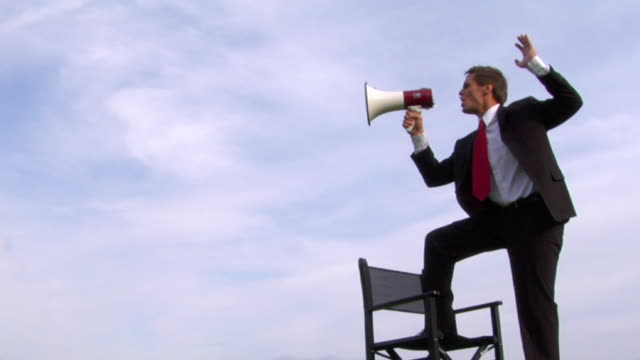 yelling.. - megaphone stock videos & royalty-free footage
