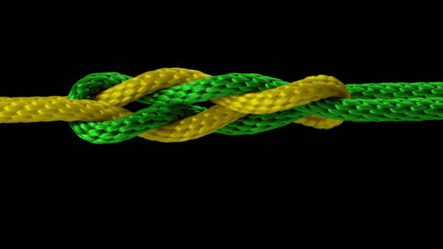 slo mo ld yellow and green rope tied into a knot - rope stock videos & royalty-free footage