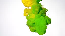 Yellow and green watercolor ink mixed in water on a white background. Abstract background. Slow motion of colored acrylic paints in water.