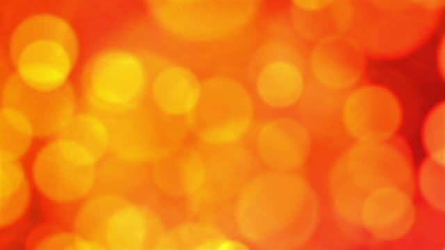 yellow and orange particles flowing in and out of each other. - other stock videos and b-roll footage