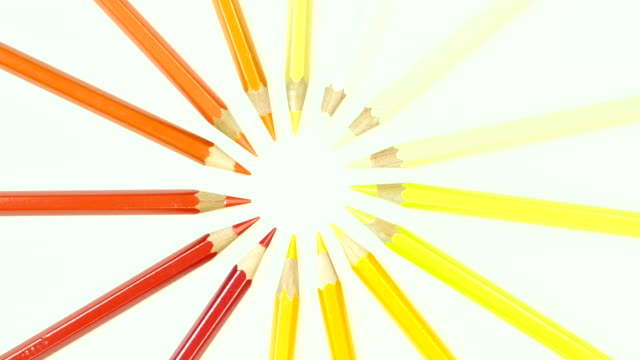 Yellow and orange tone color pencil. Top view.