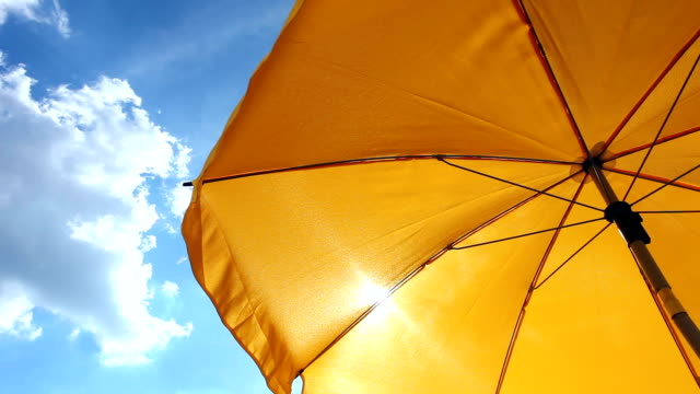 yellow beach umbrella - parasol stock videos & royalty-free footage