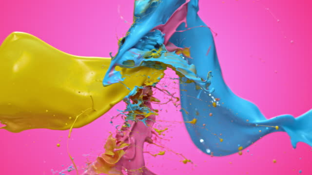slo mo yellow, blue and pink color collision - colori video stock e b–roll