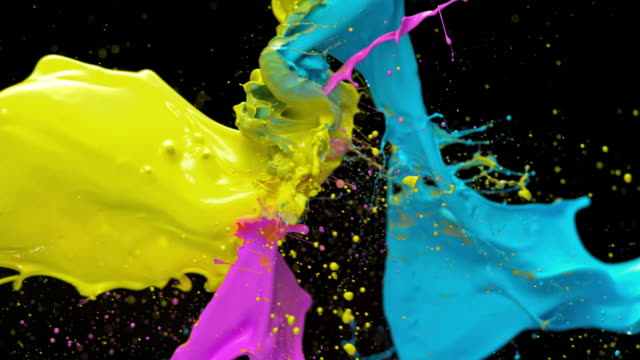 slo mo yellow, blue and pink color collision - kunst und handwerksmaterial stock-videos und b-roll-filmmaterial