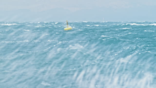 yellow buoy rocking in the rough sea - weather stock videos & royalty-free footage