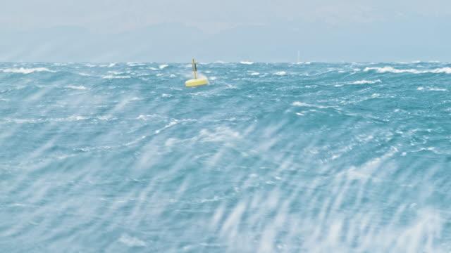 gula boj gunga i grov havet - väder bildbanksvideor och videomaterial från bakom kulisserna