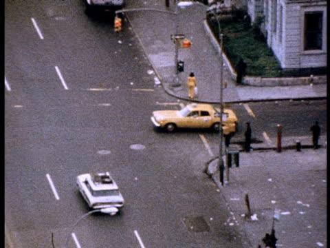 yellow cab driving through harlem; 1970s - harlem stock videos & royalty-free footage