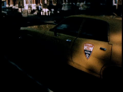 Yellow cab driving through streets of Harlem; 1970s