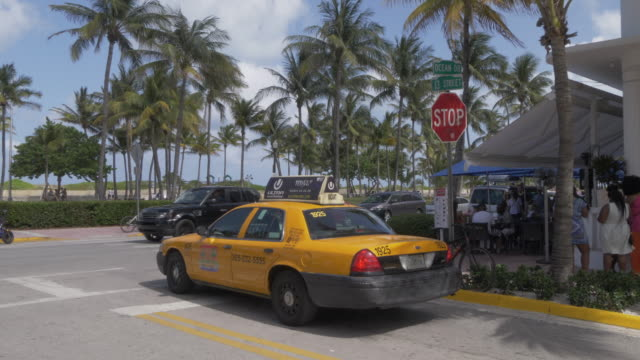Yellow cab turning onto Ocean Drive, Ocean Drive, South Beach, Miami, Florida, United States of America, North America