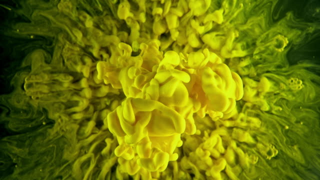 slo mo yellow color splash under the water - ideas stock videos & royalty-free footage