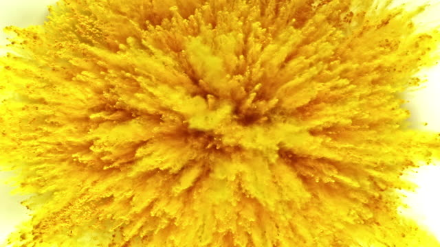 yellow colored powder exploding towards camera in close up and super slow-motion, white background - backgrounds stock videos & royalty-free footage