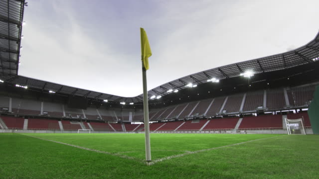 ds yellow corner flag in an empty football stadium - stadium stock videos & royalty-free footage