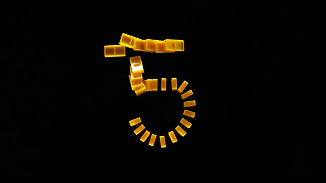 "slo mo ld yellow domino tiles shaped as ""5"" falling on black surface - number 5 stock videos & royalty-free footage"