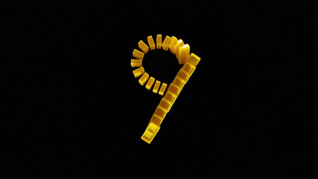 "slo mo ld yellow domino tiles shaped as ""9"" falling on black surface - number 9 stock videos & royalty-free footage"