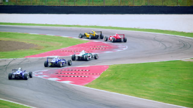 yellow formula leading in the race - crash helmet stock videos & royalty-free footage