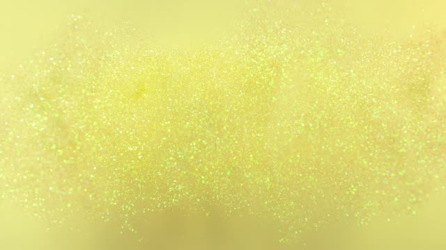"""vidéos et rushes de yellow glittering word """"yellow"""" exploding towards camera and becoming defocused on yellow background - yellow"""