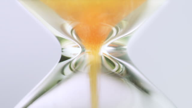 slo mo yellow golden sand hourglass - hourglass stock videos & royalty-free footage
