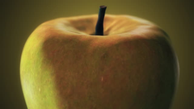 vídeos de stock, filmes e b-roll de maçã verde amarela - manipulação digital