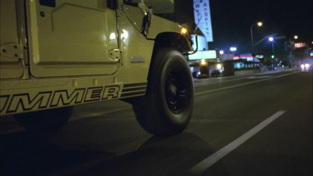 ws pov yellow hummer on city street - general motors video stock e b–roll