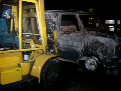 Yellow Jcb Lift Truck Carried Burnt Out Car Following Fierce Rioting