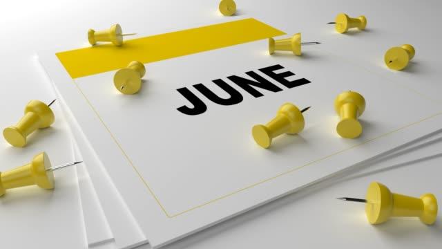 gelb juni-kalender auf weißem hintergrund mit gelben pins - kalender stock-videos und b-roll-filmmaterial
