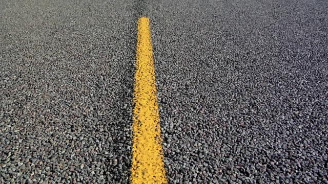 ecu yellow marking on rural road in south dakota, usa - south dakota stock-videos und b-roll-filmmaterial