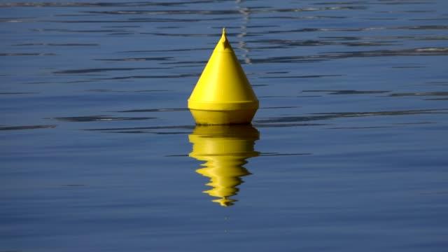 yellow moored buoy, majorca, balearic islands, spain, mediterranean, europe - buoy stock videos & royalty-free footage