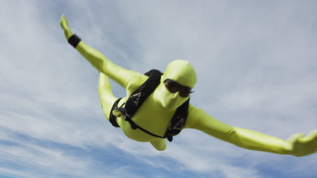 yellow morph suit skydiver - fancy dress costume stock videos & royalty-free footage