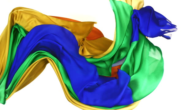 yellow, orange, green and blue silky fabrics flowing and waving horizontally in super slow motion and close up, white background - design stock videos & royalty-free footage