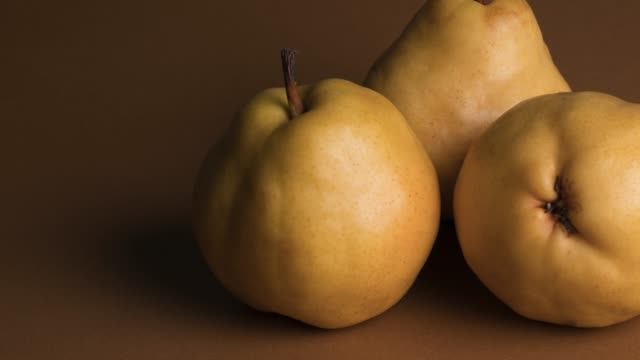 yellow pear over brown background - brown background stock videos & royalty-free footage