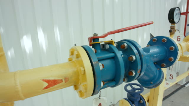 Yellow Pipeline with couple of pressure gauges on it