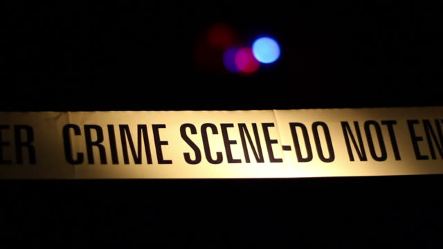 Yellow police Crime scene tape corden & siren in background