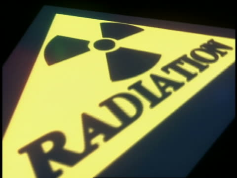 cgi yellow radiation sign with black background - warning sign stock videos & royalty-free footage