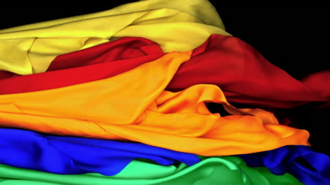 yellow, red, green, blue and orange silky fabrics flowing and waving upward in super slow motion and close up, black background - weaving stock videos & royalty-free footage