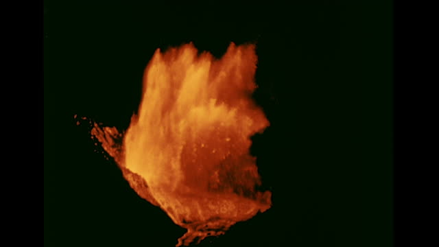 WS Yellow red lava spewing up against black volcano erupting hot molten lava rising in layers MS Lava falling 'raining' into pool of same XHA WS Lava...